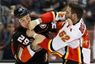 ANAHEIM, CA - NOVEMBER 24:  Chris Stewart #29 of the Anaheim Ducks fights with Brandon Bollig #52 of the Calgary Flames during the first period of a game at Honda Center on November 24, 2015 in Anaheim, California.  (Photo by Sean M. Haffey/Getty Images)