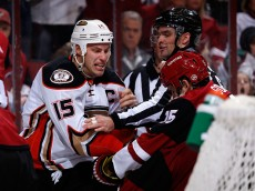 GLENDALE, AZ - NOVEMBER 25:  Ryan Getzlaf #15 of the Anaheim Ducks is called for roughing as he scrums with Boyd Gordon #15 of the Arizona Coyotes during the second period of the NHL game at Gila River Arena on November 25, 2015 in Glendale, Arizona.  (Photo by Christian Petersen/Getty Images)
