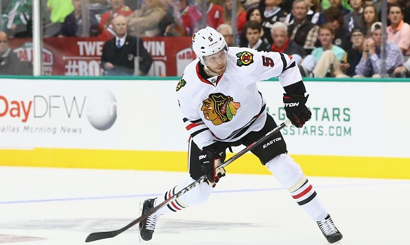 DALLAS, TX - OCTOBER 09:  David Rundblad #5 of the Chicago Blackhawks in the second period at American Airlines Center on October 9, 2014 in Dallas, Texas.  (Photo by Ronald Martinez/Getty Images)