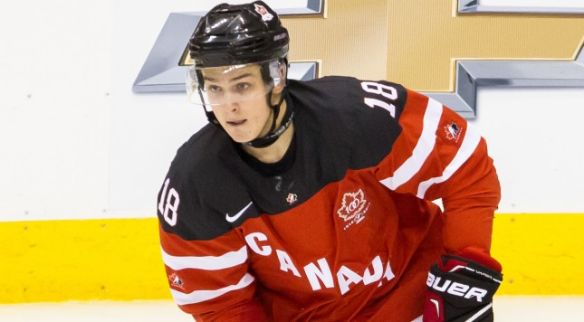 TORONTO, ON - JANUARY 05: Forward Jake Virtanen #18 of Canada moves the puck against Russia during the Gold medal game of the 2015 IIHF World Junior Championship on January 05, 2015 at the Air Canada Centre in Toronto, Ontario, Canada. (Photo by Dennis Pajot/Getty Images)