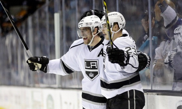 SAN JOSE, CA - APRIL 30:  Dustin Brown #23 of the Los Angeles Kings is congratulated by Anze Kopitar #11 after he scored an empty-net goal in the third period of their win over the San Jose Sharks in Game Seven of the First Round of the 2014 NHL Stanley Cup Playoffs at SAP Center on April 30, 2014 in San Jose, California.  (Photo by Ezra Shaw/Getty Images)