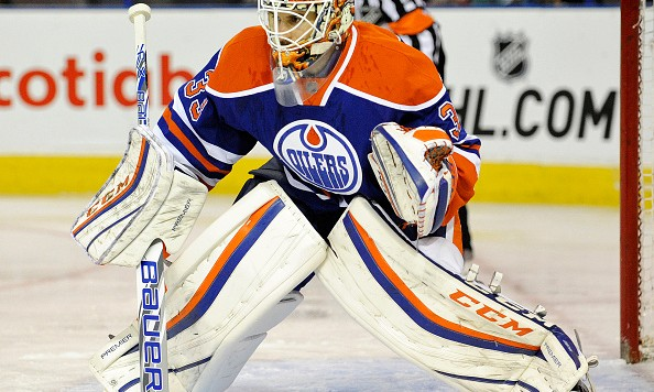 EDMONTON , AB - SEPTEMBER 21:  Goalie Cam Talbot #33 of the Edmonton Oilers sets for a shot against the Calgary Flames at Rexall Place on September 21, 2015 in Edmonton, Alberta, Canada.(Photo by Dan Riedlhuber/Getty Images)