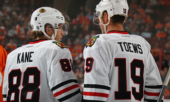 PHILADELPHIA, PA - OCTOBER 14:  Jonathan Toews #19 and Patrick Kane #88 of the Chicago Blackhawks skate against the Philadelphia Flyers at the Wells Fargo Center on October 14, 2015 in Philadelphia, Pennsylvania.  (Photo by Bruce Bennett/Getty Images)