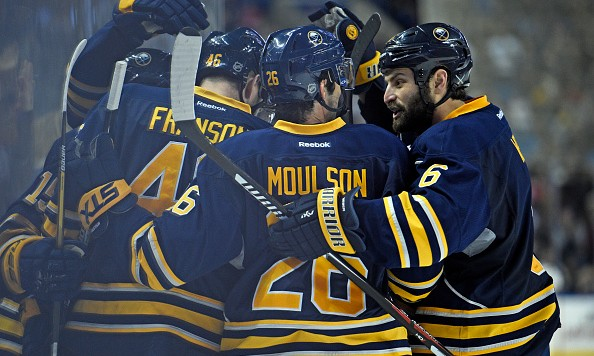 BUFFALO, NY - DECEMBER 19: From left to right: Teammates Cody Franson #46, Matt Moulson #26, and Mike Weber #6 of the Buffalo Sabres celebrate after Cody Franson scored a goal during the game against the Chicago Blackhawks at the First Niagara Center on December 19, 2015 in Buffalo, New York. The Blackhawks and Sabres are tied 1-1 at the end of the second period. (Photo by Tom Brenner/ Getty Images)