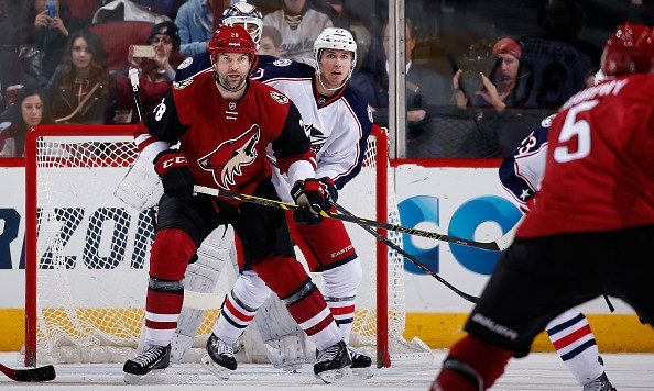 GLENDALE, AZ - DECEMBER 17:  John Scott #28 of the Arizona Coyotes sets up in front of Ryan Murray #27 of the Columbus Blue Jackets during the NHL game at Gila River Arena on December 17, 2015 in Glendale, Arizona.  The Blue Jackets defeated the Coyotes 7-5.  (Photo by Christian Petersen/Getty Images)