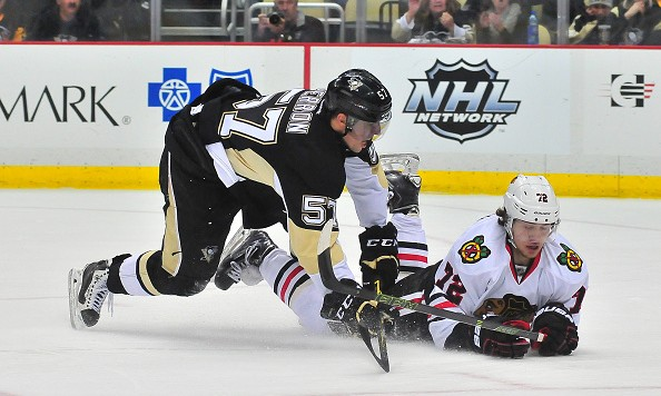 PITTSBURGH, PA - JANUARY 5: David Perron #57 of the Pittsburgh Penguins falls to the ice against the Chicago Blackhawks during the game at Consol Energy Center on January 5, 2016 in Pittsburgh, Pennsylvania. (Photo by Matt Kincaid/Getty Images)