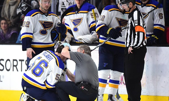 LOS ANGELES, CA - JANUARY 09:  Magnus Paajarvi #56 of the St. Louis Blues receives attention from a trainer after a check from Brayden McNabb #3 of the Los Angeles Kings during the third period at Staples Center on January 9, 2016 in Los Angeles, California.  (Photo by Harry How/Getty Images)