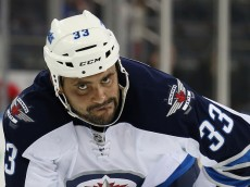 NEW YORK, NY - NOVEMBER 01: Dustin Byfuglien #33 of the Winnipeg Jets waits for a faceoff during the third period against the New York Rangers at Madison Square Garden on November 1, 2014 in New York City.  The Jets defeated the Rangers 1-0 in the shootout. (Photo by Bruce Bennett/Getty Images)