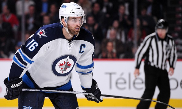 MONTREAL, QC - NOVEMBER 11:  Andrew Ladd #16 of the Winnipeg Jets waits for a face-off during the NHL game  against the Montreal Canadiens at the Bell Centre on November 11, 2014 in Montreal, Quebec, Canada.  The Canadiens defeated the Jets 3-0.  (Photo by Richard Wolowicz/Getty Images)