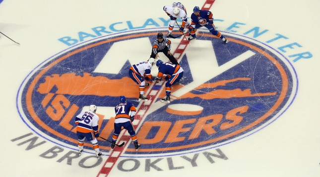 NEW YORK, NY - JULY 08: The puck is dropped for the start of the 2015 New York Islanders Blue & White Rookie Scrimmage & Skills Competition at the Barclays Center on July 8, 2015 in Brooklyn borough of New York City.  (Photo by Bruce Bennett/Getty Images)