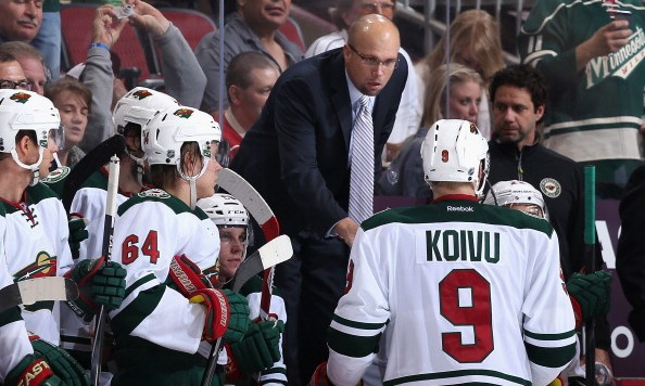 GLENDALE, AZ - MARCH 29:  Head coach Mike Yeo of the Minnesota Wild talks with Mikko Koivu #9 during a break from the NHL game against the Phoenix Coyotes at Jobing.com Arena on March 29, 2014 in Glendale, Arizona. The Wild defeated the Coyotes 3-1. (Photo by Christian Petersen/Getty Images)