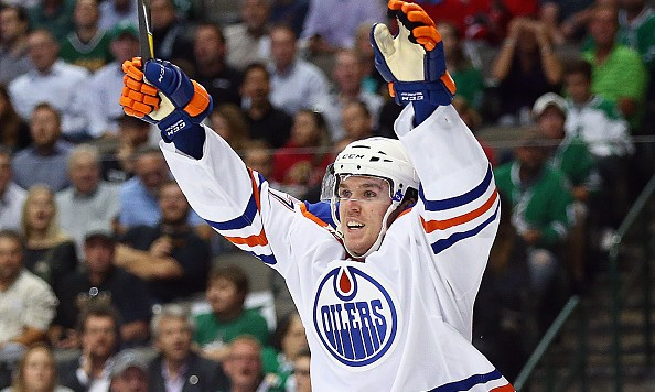 DALLAS, TX - OCTOBER 13:  Connor McDavid #97 of the Edmonton Oilers celebrates his first career NHL goal against the Dallas Stars in the second period at American Airlines Center on October 13, 2015 in Dallas, Texas.  (Photo by Ronald Martinez/Getty Images)