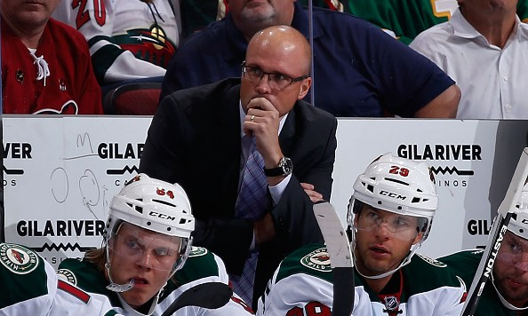 GLENDALE, AZ - OCTOBER 15:  Head coach Mike Yeo of the Minnesota Wild watches from the bench during the NHL game against the Arizona Coyotes at Gila River Arena on October 15, 2015 in Glendale, Arizona.  The Wild defeated the Coyotes 4-3.  (Photo by Christian Petersen/Getty Images)