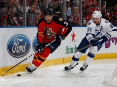SUNRISE, FL - JANUARY 23: Steven Stamkos #91 of the Tampa Bay Lightning chases Aaron Ekblad #5 of the Florida Panthers as he circles the net with the puck at the BB&T Center on January 23, 2016 in Sunrise, Florida. The Panthers defeated the Lightning 5-2. (Photo by Joel Auerbach/Getty Images)