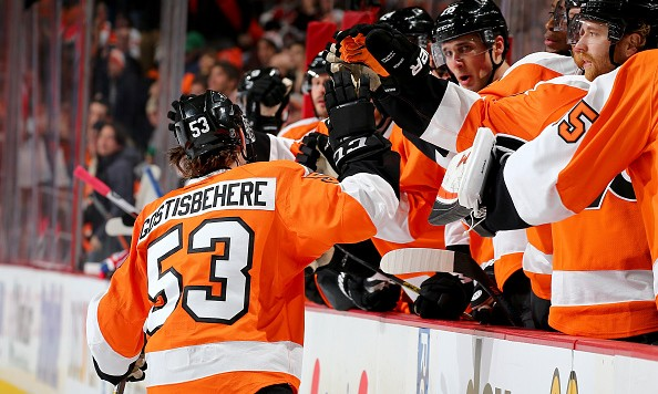 PHILADELPHIA, PA - JANUARY 05:  Shayne Gostisbehere #53 of the Philadelphia Flyers celebrates his goal with teammates on the bench in the second period at the Wells Fargo Center on January 5, 2016 in Philadelphia, Pennsylvania.  (Photo by Elsa/Getty Images)
