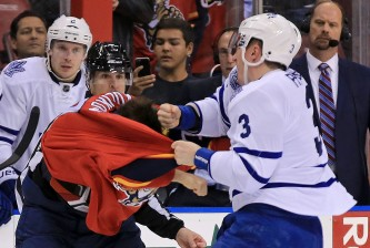 SUNRISE, FL - JANUARY 26: Dmitry Kulikov #7 of the Florida Panthers and Dion Phaneuf #3 of the Toronto Maple Leafs fight during a game at BB&T Center on January 26, 2016 in Sunrise, Florida.  (Photo by Mike Ehrmann/Getty Images)
