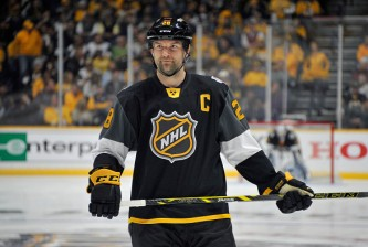 NASHVILLE, TN - JANUARY 31:  John Scott #28 of the Arizona Coyotes looks on during the 2016 Honda NHL All-Star Final Game between the Eastern Conference and the Western Conference at Bridgestone Arena on January 31, 2016 in Nashville, Tennessee.  (Photo by Frederick Breedon/Getty Images)