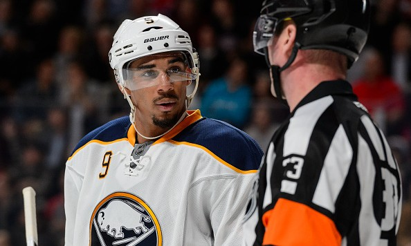 MONTREAL, QC - FEBRUARY 03:  Evander Kane #9 of the Buffalo Sabres speaks with referee Kevin Pollock #33 during the NHL game against the Montreal Canadiens at the Bell Centre on February 3, 2016 in Montreal, Quebec, Canada.  The Buffalo Sabres defeated the Montreal Canadiens 4-2.  (Photo by Minas Panagiotakis/Getty Images)