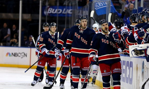 NEW YORK, NY - FEBRUARY 17:  Dan Boyle #22 of the New York Rangers celebrates his goal with teammates on the bench in the third period against the Chicago Blackhawks at Madison Square Garden on February 17, 2016 in New York City.The Chicago Blackhawks defeated the New York Rangers 5-3.  (Photo by Elsa/Getty Images)