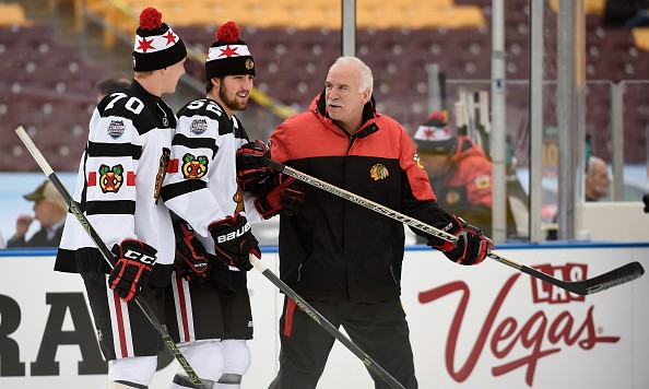 MINNEAPOLIS, MN - FEBRUARY 20: Head coach Joel Quenneville of the Chicago Blackhawks speaks with Dennis Rasmussen #70 and Erik Gustafsson #52 during practice day at the 2016 Coors Light Stadium Series on February 20, 2016 at TCF Bank Stadium in Minneapolis, Minnesota. (Photo by Hannah Foslien/Getty Images)