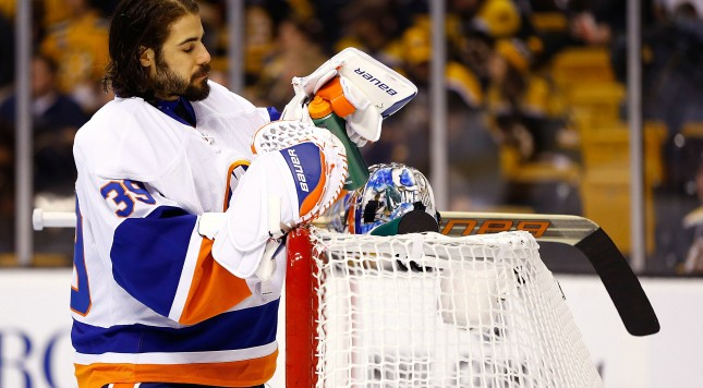 BOSTON, MA - JANUARY 25: Rick DiPietro #39 of the New York Islanders takes a drink from his Gatorade bottle while standing in goal against the Boston Bruins during the game on January 25, 2013 at TD Garden in Boston, Massachusetts. (Photo by Jared Wickerham/Getty Images)