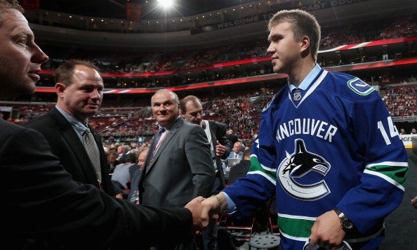 PHILADELPHIA, PA - JUNE 28:  Nikita Tryamkin meets with his team after being drafted #66 by the Vancouver Canucks on Day Two of the 2014 NHL Draft at the Wells Fargo Center on June 28, 2014 in Philadelphia, Pennsylvania.  (Photo by Bruce Bennett/Getty Images)
