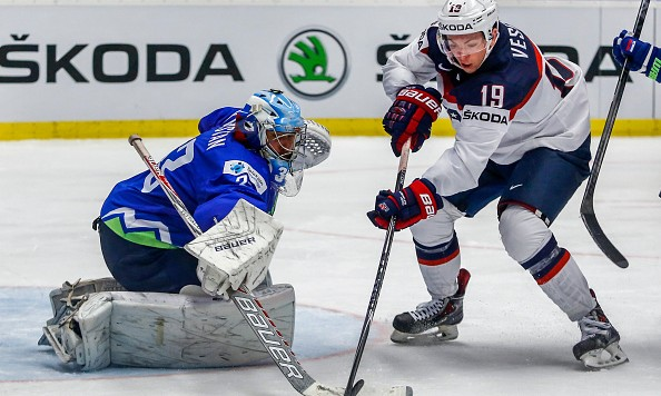 OSTRAVA, CZECH REPUBLIC - MAY 10:  Jimmy Vesey (R) of USA tries to score against Robert Kristan (L), goalkeeper of Slovenia, during the IIHF World Championship group B match between Slovenia and USA at CEZ Arena on May 10, 2015 in Ostrava, Czech Republic.  (Photo by Matej Divizna/Getty Images)