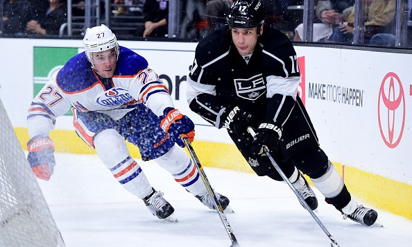 LOS ANGELES, CA - FEBRUARY 25:  Milan Lucic #17 of the Los Angeles Kings circles the net with the puck as Adam Clendening #27 of the Edmonton Oilers gives chase during the second period at Staples Center on February 25, 2016 in Los Angeles, California.  (Photo by Harry How/Getty Images)