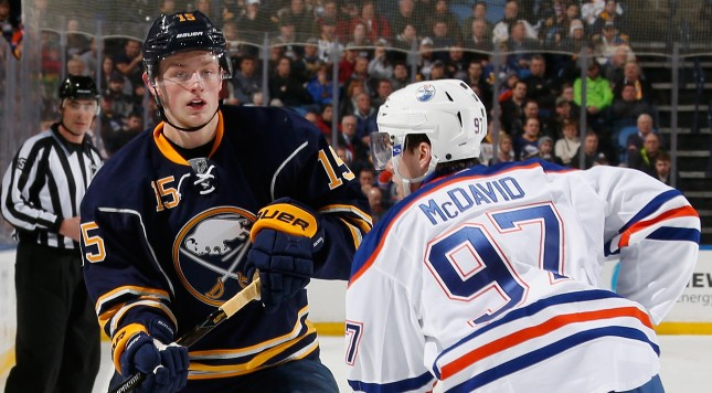 BUFFALO, NY - MARCH 01: Jack Eichel #15 of the Buffalo Sabres passes the puck against Connor McDavid #97 of the Edmonton Oilers at First Niagara Center on March 1, 2016 in Buffalo, New York.  (Photo by Jen Fuller/Getty Images)