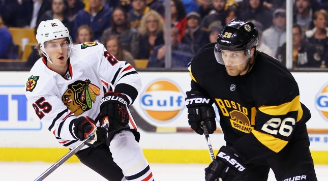 BOSTON, MA - MARCH 03:  Dale Weise #25 of the Chicago Blackhawks defends John-Michael Liles #26 of the Boston Bruins during the second period at TD Garden on March 3, 2016 in Boston, Massachusetts.  (Photo by Maddie Meyer/Getty Images)