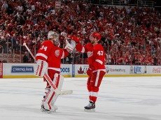 DETROIT, MI - APRIL 17:  Petr Mrazek #34 of the Detroit Red Wings celebrates a 2-0 victory over the Tampa Bay Lightning in Game Three of the Eastern Conference Quarterfinals with Darren Helm #43 during the 2016 NHL Stanley Cup Playoffs at Joe Louis Arena on April 17, 2016 in Detroit, Michigan. Tampa Bay leads the series 2-1. (Photo by Gregory Shamus/Getty Images)