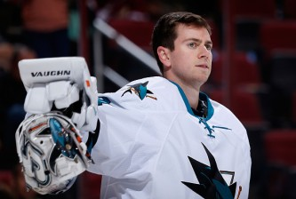 GLENDALE, AZ - OCTOBER 02:  Goaltender Martin Jones #31 of the San Jose Sharks puts on his mask during a break from the NHL preseason game against the Arizona Coyotes at Gila River Arena on October 2, 2015 in Glendale, Arizona.  The Sharks defeated the Coyotes 3-0. (Photo by Christian Petersen/Getty Images)