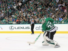 DALLAS, TX - APRIL 29:  Kari Lehtonen #32 of the Dallas Stars clears the puck against the St. Louis Blues in the second period in Game One of the Western Conference Second Round during the 2016 NHL Stanley Cup Playoffs at American Airlines Center on April 29, 2016 in Dallas, Texas.  (Photo by Tom Pennington/Getty Images)