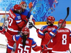 SOCHI, RUSSIA - FEBRUARY 11:  Anna Shibanova #70 of Russia celebrates with teammate Anna Prugova #1 after defeating Team Japan 2 to 1 in their Women's Ice Hockey Preliminary Round Group B game on day four of the Sochi 2014 Winter Olympics at Shayba Arena on February 11, 2014 in Sochi, Russia.  (Photo by Martin Rose/Getty Images)