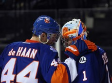 NEW YORK, NY - NOVEMBER 30: Calvin de Haan #44 and Thomas Greiss #1 of the New York Islanders celebrate their win over the Colorado Avalanche at the Barclays Center on November 30, 2015 in the Brooklyn borough of New York City. The Islanders defeated the Avalanche 5-3.  (Photo by Bruce Bennett/Getty Images)