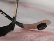 NEW YORK - APRIL 04: Sticks and the puck photogarphed during a faceoff between the New York Islanders and the New York Rangers on April 4, 2008 at Madison Square Garden in New York City. (Photo by Bruce Bennett/Getty Images)