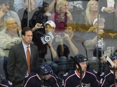 WINNIPEG, CANADA - SEPTEMBER 20: Heach coach Scott Arniel of the Columbus Blue Jackets has some Winnipeg Jet fans show him who they are cheering for at the MTS Centre on September 20, 2011 in Winnipeg, Manitoba, Canada. (Photo by Marianne Helm/Getty Images)