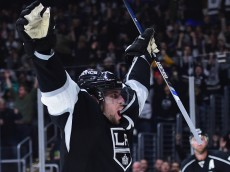 LOS ANGELES, CA - DECEMBER 01:  Anze Kopitar #11 of the Los Angeles Kings celebrates his overtime goal for a 2-1 win over the Vancouver Canucks at Staples Center on December 1, 2015 in Los Angeles, California.  (Photo by Harry How/Getty Images)