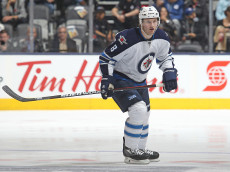 TORONTO, ON - NOVEMBER 4:  Jacob Trouba #8 of the Winnipeg Jets skates against the Toronto Maple Leafs during an NHL game at the Air Canada Centre on November 4, 2015 in Toronto, Ontario, Canada. The Jets defeated the Maple Leafs 4-2. (Photo by Claus Andersen/Getty Images)