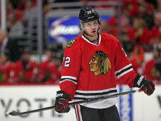 CHICAGO, IL - JANUARY 17:  Artemi Panarin #72 of the Chicago Blackhawks takes a break during a time-out against the Montreal Canadiens at the United Center on January 17, 2016 in Chicago, Illinois. The Blackhawks defeated the Canadiens 5-2.  (Photo by Jonathan Daniel/Getty Images)