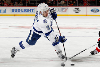 NEWARK, NJ - FEBRUARY 26: Tyler Johnson #9 of the Tampa Bay Lightning takes a slapshot against the New Jersey Devils during the first period at the Prudential Center on February 26, 2016 in Newark, New Jersey.  (Photo by Bruce Bennett/Getty Images)