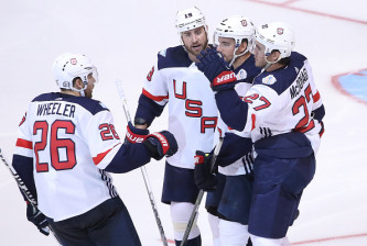 TORONTO, ON - SEPTEMBER 22: Ryan McDonagh #27 of Team USA is congratulated on his goal by Brandon Dubinsky #19 and Matt Niskanen #2 and Blake Wheeler #26 against Team Czech Republic during the World Cup of Hockey tournament at the Air Canada Centre on September 22, 2016 in Toronto, Canada. (Photo by Tom Szczerbowski/Getty Images)