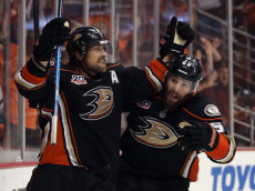 ANAHEIM, CA - MAY 03:  Teemu Selanne #8 and Patrick Maroon #62 of the Anaheim Ducks celebrate Selanne's third period goal against the Los Angeles Kings in Game One of the Second Round of the 2014 NHL Stanley Cup Playoffs at Honda Center on May 3, 2014 in Anaheim, California.  (Photo by Jeff Gross/Getty Images)