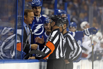 TAMPA, FL - OCTOBER 18:  Referee Gord Dwyer #19 explains the reversal of a Florida Panthers shootout goal to head coach John Cooper of the Tampa Bay Lightning during the game at the Amalie Arena on October 18, 2016 in Tampa, Florida. (Photo by Mike Carlson/Getty Images)