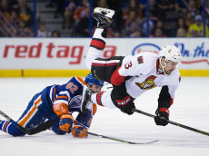 EDMONTON, AB - FEBRUARY 23:  Jordan Oesterle #82 of the Edmonton Oilers trips up Nick Paul #13 of the Ottawa Senators on February 23, 2016 at Rexall Place in Edmonton, Alberta, Canada. (Photo by Codie McLachlan/Getty Images)