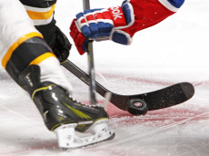 MONTREAL, QC - MAY 12: The puck bounces on the ice during a face-off between the Montreal Canadiens and the Boston Bruins in Game Six of the Second Round of the 2014 NHL Stanley Cup Playoffs at the Bell Centre on May 12, 2014 in Montreal, Quebec, Canada. (Photo by Francois Laplante/Freestyle Photography/Getty Images)
