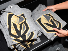 LAS VEGAS, NV - NOVEMBER 22:  T-shirts with the team logo for the Vegas Golden Knights are folded and stacked after being announced as the name for the Las Vegas NHL franchise at T-Mobile Arena on November 22, 2016 in Las Vegas, Nevada. The team will begin play in the 2017-18 season.  (Photo by Ethan Miller/Getty Images)