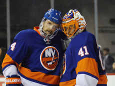 NEW YORK, NY - DECEMBER 06: Dennis Seidenberg #4 and Jaroslav Halak #41 of the New York Islanders celebrate a 4-2 victory over the New York Rangers at the Barclays Center on December 6, 2016 in the Brooklyn borough of New York City.  (Photo by Bruce Bennett/Getty Images)