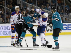SAN JOSE, CA - DECEMBER 23:  Brenden Dillon #4 of the San Jose Sharks and Matt Hendricks #23 of the Edmonton Oilers fight during the first period at SAP Center on December 23, 2016 in San Jose, California.  (Photo by Ezra Shaw/Getty Images)