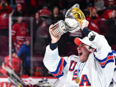 MONTREAL, QC - JANUARY 05:  Team captain Luke Kunin #9 of Team United States skates off with the IIHF trophy during the 2017 IIHF World Junior Championship gold medal game against Team Canada at the Bell Centre on January 5, 2017 in Montreal, Quebec, Canada.  Team United States defeated Team Canada 5-4 in a shootout and won the gold medal round.  (Photo by Minas Panagiotakis/Getty Images)